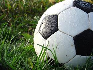 Soccer Ball In The Grass Covered By Rain